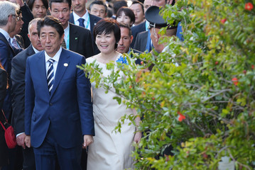 Japan's Prime Minister Shinzo Abe and his wife Akie Abe arrive for a concert of La Scala Philharmonic Orchestra during the Heads of State and of Government G7 summit in Sicily