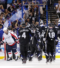 Knuble reacts as members of the Tampa Bay Lightning celebrate their series victory after Game 4 of their NHL Eastern Conference semi-final hockey game in Tampa, Florida