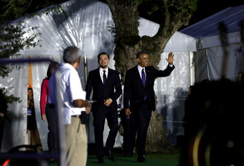 President Barack Obama waves as he arrives with actor Leonardo DiCaprio to discuss the importance of protecting the one planet  at South by South Lawn event at the White House in Washington