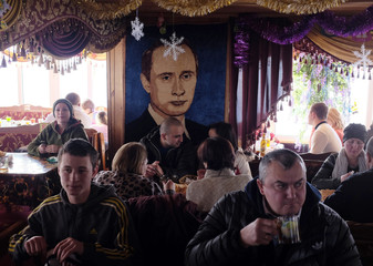 A portrait of Russian President Vladimir Putin is on display at a cafe in the settlement of Dombai