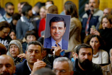 A supporter holds a portrait of detained leader of Turkey's pro-Kurdish opposition Peoples' Democratic Party (HDP) Selahattin Demirtas at the Turkish parliament in Ankara