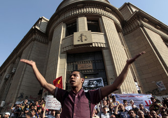 Anti-military protesters chant slogans against military rulers during a rally outside the Egyptian Supreme Court in Cairo