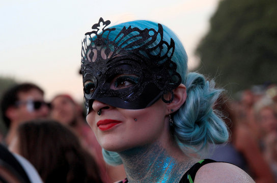 A festivalgoer attends a concert by the British singer Tinie Tempah during Sziget music festival on an island in the Danube River in Budapest