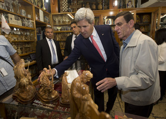 """U.S. Secretary of State Kerry shops at """"The Nativity Store"""" alongside its owner Victor Tabash at Manger Square in Bethlehem"""