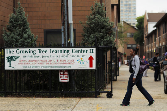 A woman walks past The Growing Tree Learning Center II in Jersey City, New Jersey