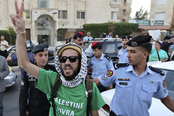 A pro-Palestinian activist flashes the victory sign as he is released by Jordanian police after being detained for sitting in front of the Israeli embassy during a demonstration in Amman