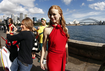 Wax figures of Australian celebrities Kerr, Urban,  Hewitt and Kidman are placed for pictures in front of the Sydney Opera House and harbour bridge