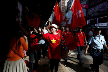 Pro-China supporters march to celebrate China's National Day in Hong Kong