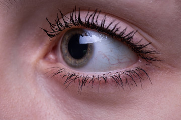 Teenage girl's eye looking side