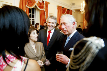 Britain's Prince Charles talks to guests at a reception for him and his wife Camilla, Duchess of Cornwall, in Washington