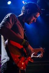 Guitarist playing guitar on stage