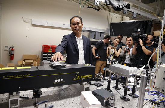 Japanese-born U.S. citizen Nakamura talks about a laser in a lab after winning the 2014 Nobel Prize for Physics, at the University of California Santa Barbara in Isla Vista