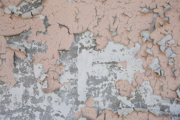 pink peeling paint on concrete wall texture