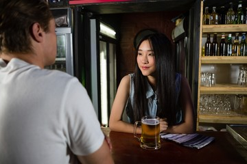 Bartender interacting with customer
