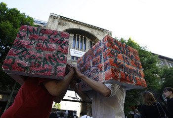 Performers wear boxes designed as brick walls during a demonstration to support the embattled Tacheles art house in central Berlin
