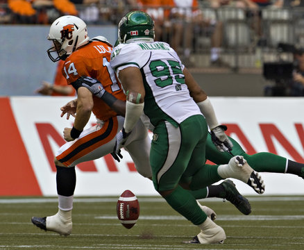 BC Lions Lulay fumbles while being chased by Saskatchewan Roughriders Williams during CFL football game in Vancouver