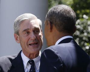 U.S. President Barack Obama speaks with outgoing FBI director Robert Mueller in the Rose Garden of the White House in Washington