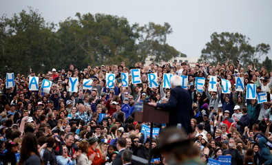 U.S. Democratic presidential candidate Bernie Sanders looks as supporters wish him and his wife a happy wedding anniversary at a campaign rally in Santa Barbara