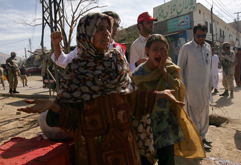 Road vendors react after a member of their family was injured in a bomb attack in Quetta