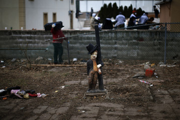 Lamp post figure is nearly all that remains of backyard of house destroyed by Hurricane Sandy in New York City