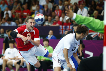 Denmark's Michael Knudsen takes a shot against South Korea in their men's handball Preliminaries Group B match at the Copper Box venue during the London 2012 Olympic Games