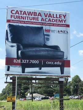 A sign for Catawba Valley Furniture Academy is seen in Newton