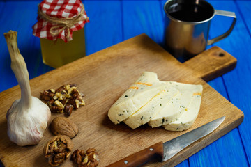 Slices of spicy cheese, served with walnuts,garlic and mug of homemade wine.