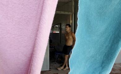 Cuban migrant Alexei Oliva stands before his journey to the Guatemala-Mexico border at a shelter in La Cruz, Costa Rica