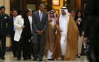 U.S. President Barack Obama and Saudi King Salman walk together following their meeting at Erga Palace in Riyadh, Saudi Arabia