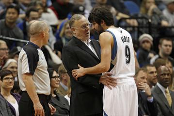 Minnesota Timberwolves head coach Adelman speaks with Rubio near end of second half of their NBA basketball game against San Antonio Spurs in Minneapolis