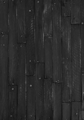 Black, rustic, rough wooden slats, dark abstract background of hard wood