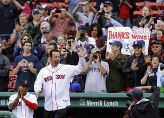 Former Boston Red Sox pitcher Wakefield waves at ceremony before the Red Sox MLB game against Seattle Mariners in Boston