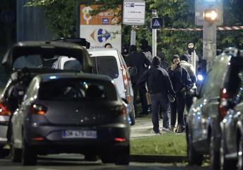 French policemen take part in a police raid in Boussy-Saint-Antoine near Paris