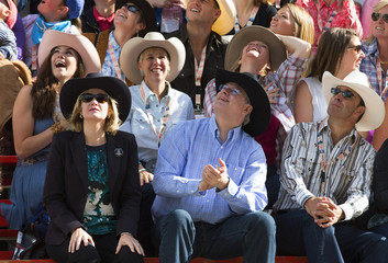 Canadian Prime Minister Harper and his wife Laureen watch the start of the 101st Calgary Stampede parade in Calgary.