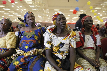 Parents of the Chibok girls weep during their meeting with President Muhammadu Buhari at the presidential villa in Abuja