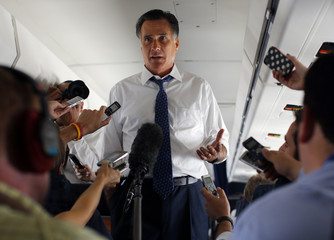 Republican presidential candidate and former Massachusetts Governor Mitt Romney talks to reporters about his phone conversation with Israeli Prime Minister Benjamin Netanyahu, on his campaign plane enroute to Bedford