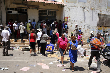 People loot a shop believed to be owned by a foreigner, during service delivery protests in Mohlakeng