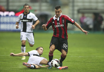 AC Milan's Stephan El Shaarawy is challenged by Parma's Gianluca Musacci during their Italian Serie A soccer match at the Tardini stadium in Parma