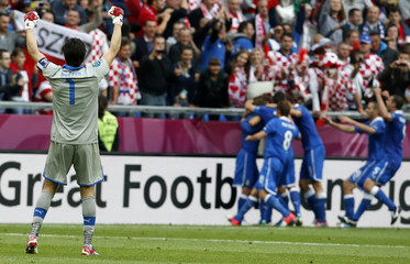 Italy's goalkeeper Buffon celebrates a goal against Croatia during their Group C Euro 2012 soccer match at city stadium in Poznan