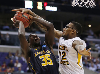 Wichita State Shockers' Hall stuffs La Salle Explorers' Brown in first half of their West Regional NCAA men's basketball game in Los Angeles