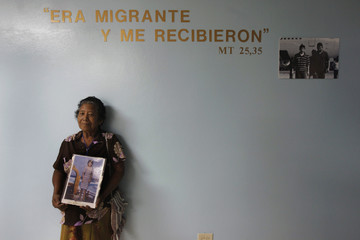 Emeterea Martinez holds a picture of her daughter Ada Ortiz, an illegal immigrant who went missing in 1989, after a mass in Tegucigalpa