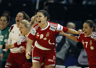 Hungary players celebrate their women's European handball championship bronze medal match victory over Serbia at the Kombank Arena in Belgrade