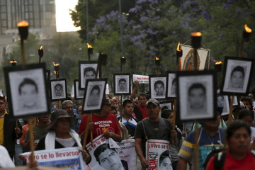 Relatives of missing students take part in march to protest against the government's handling of the investigation in  the case, in Mexico City