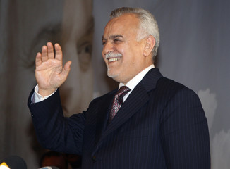 Iraq's Vice President al-Hashimi waves to crowds during his election rally in Damascus
