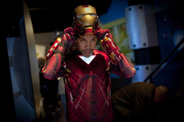"Comic book fan Felipe puts on his Iron Man character mask at the unveiling of the ""Marvel Superhero Experience"" at Madame Tussauds wax museum in New York"
