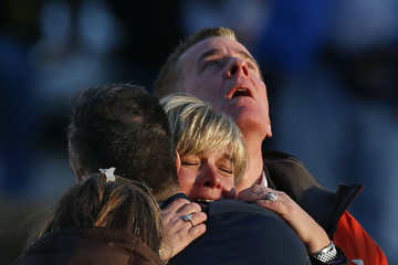 Lynn and Christopher McDonnell, the parents of seven-year-old Grace McDonnell, grieve near Sandy Hook Elementary in Newtown, Connecticut