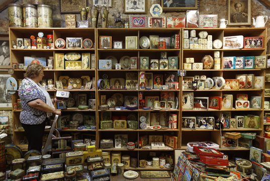 Dardenne stands among hundreds of vintage lithographed tin boxes, which are part of a huge collection displayed at her house in Grand-Hallet