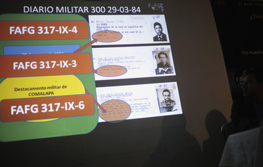 Data and photographs taken from Diario Militar of three men who were kidnapped or disappeared in 1884 are projected on wall in FAFG Guatemala City