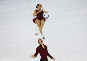 Russia's Ksenia Stolbova and Fedor Klimov compete during the Figure Skating Pairs Short Program at the Sochi 2014 Winter Olympics