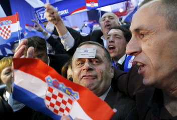 Supporters of the Croatian Democratic Union (HDZ) celebrate after exit polls in Zagreb